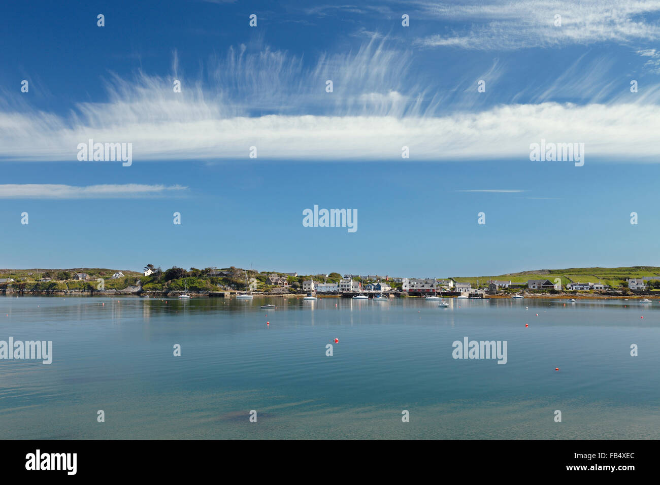 cirrus clouds above Crookhaven a vacation resort at the Crookhaven Bay on Mizen peninsula, County Cork, Ireland - Stock Image