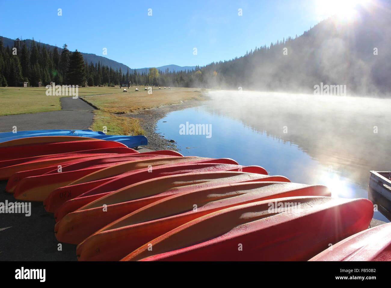 Early Morning Canoe Ride at the Lake - Stock Image