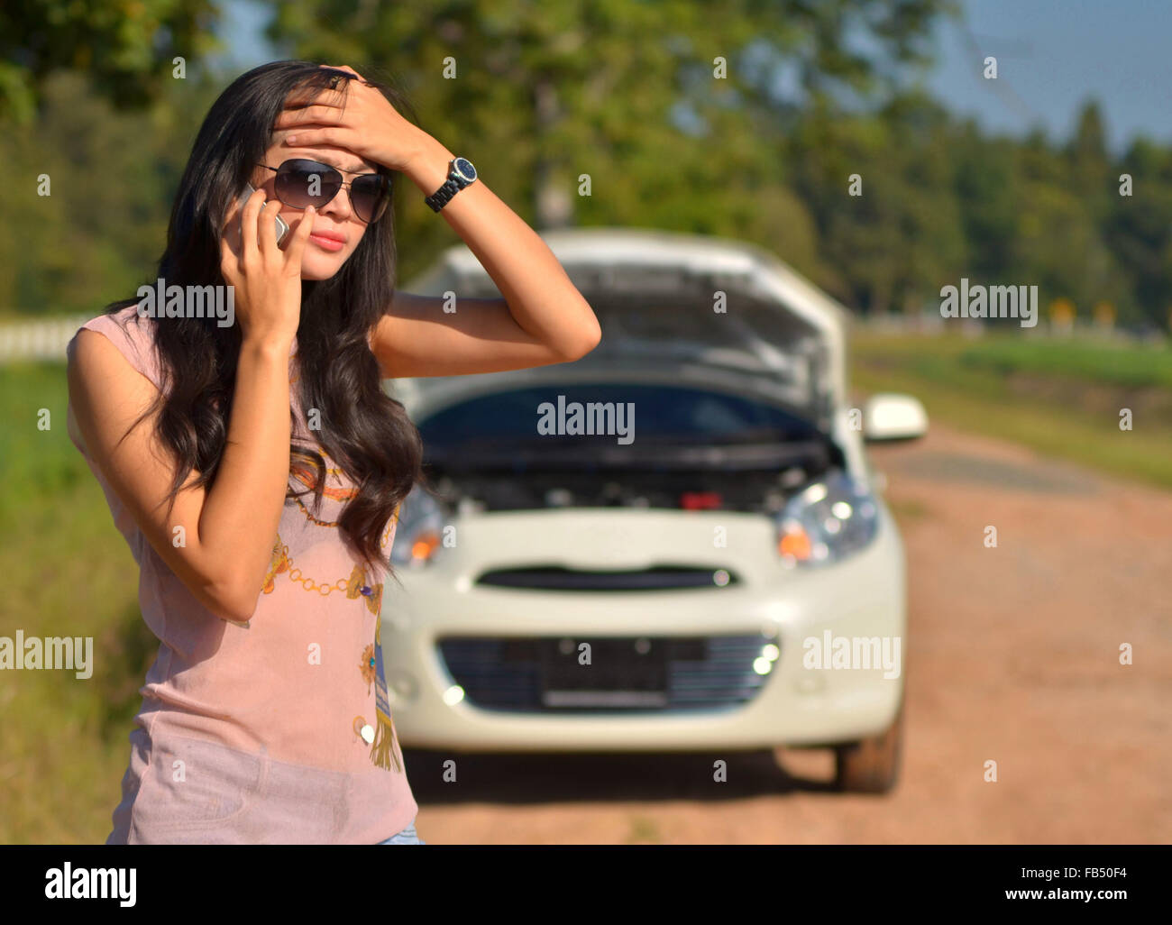 Car Broke Down >> A Woman Calls For Assistance After Her Car Broke Down Stock Photo