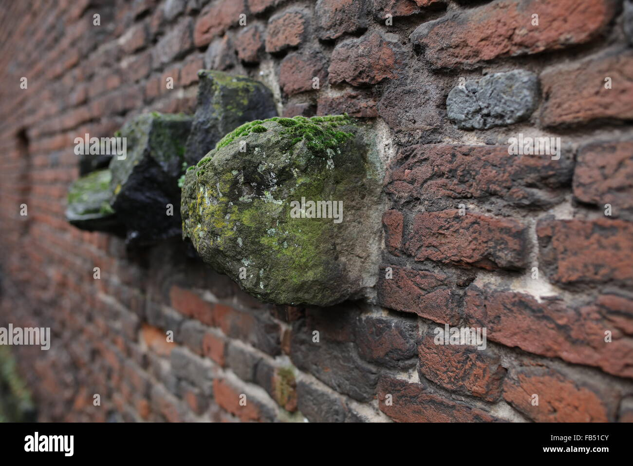 basalt stones build into a brick wall, Zons, Northrhine Westphalia NRW, Germany - Stock Image