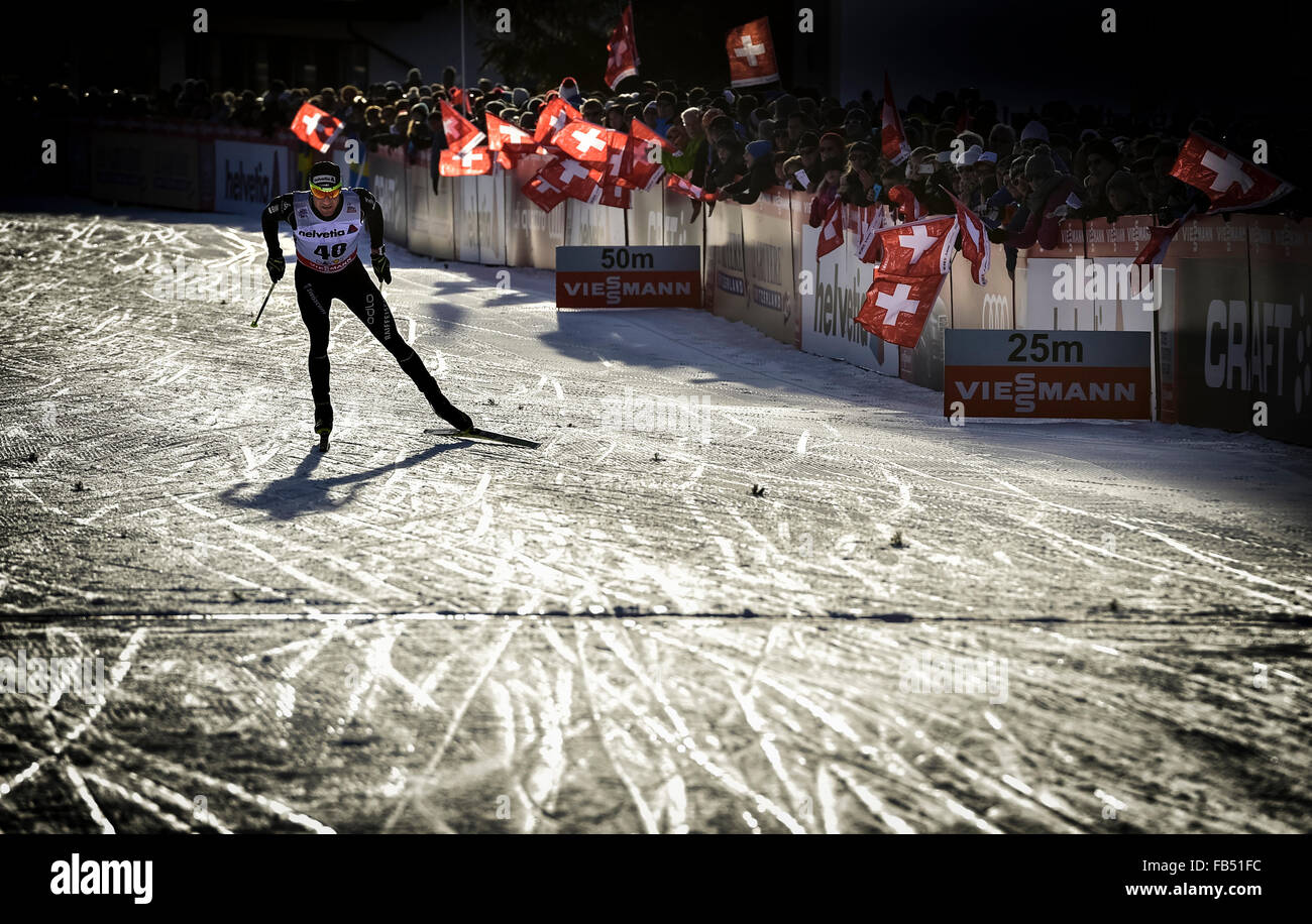 Cross-country skiers Dario Cologna, SUI, at finish line, FIS Cross-Country World Cup Davos, Switzerland - Stock Image