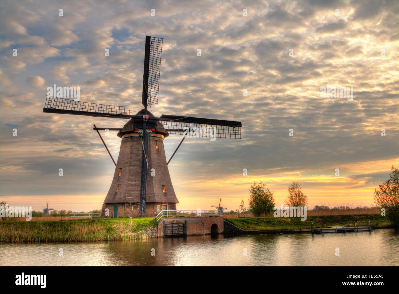 Windmill and water canal in Kinderdijk, Netherlands - Stock Image