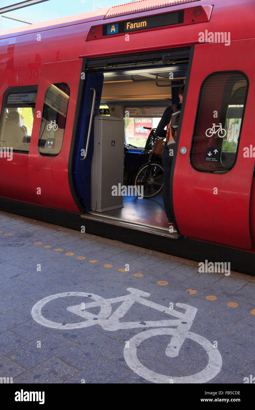 Bicycle sign on platform by S Train with cycle carriage door open in Vesterport railway station. Copenhagen Denmark - Stock Image