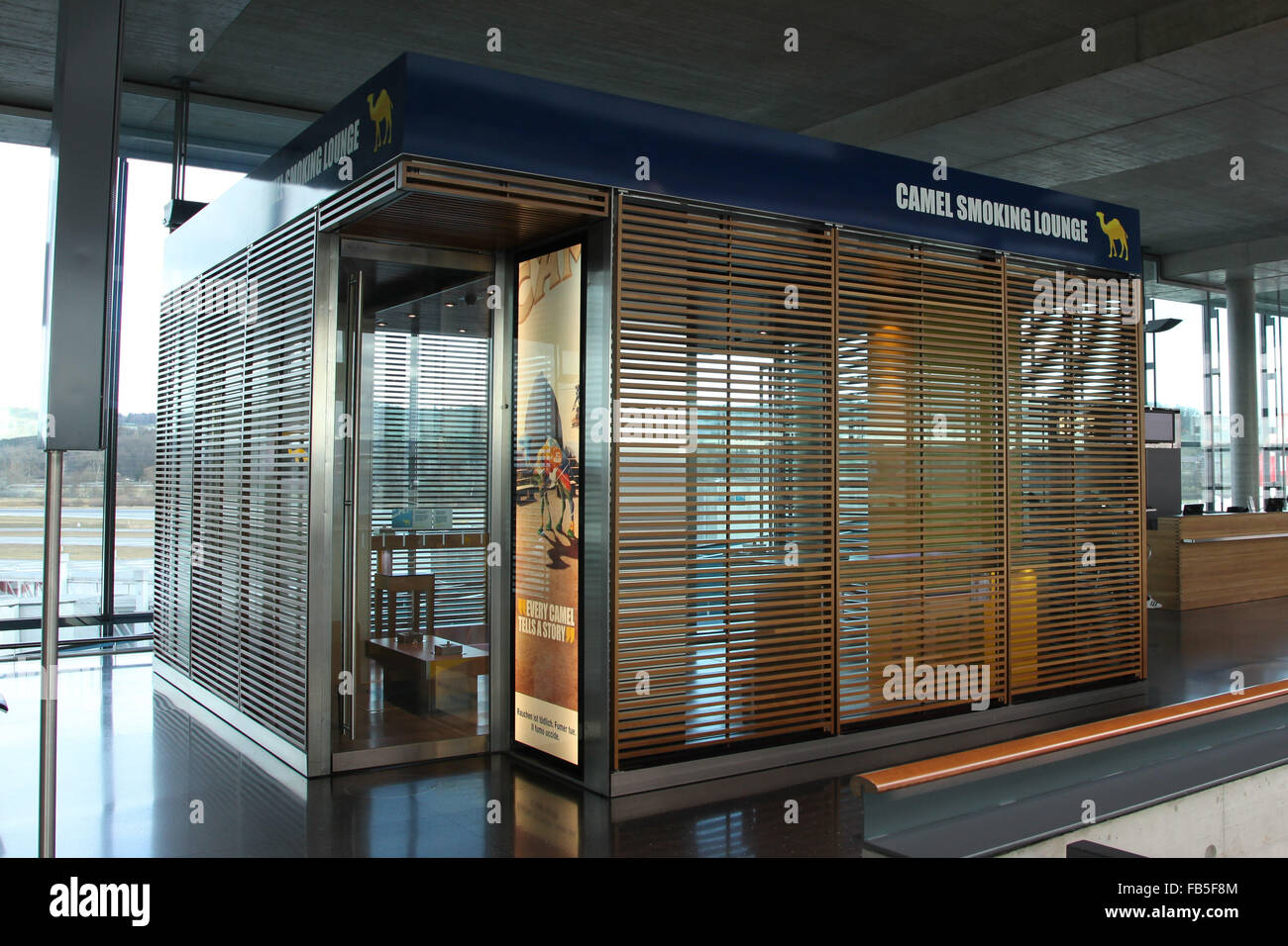 Zurich International Airport  with smoking lounge for smokers. - Stock Image