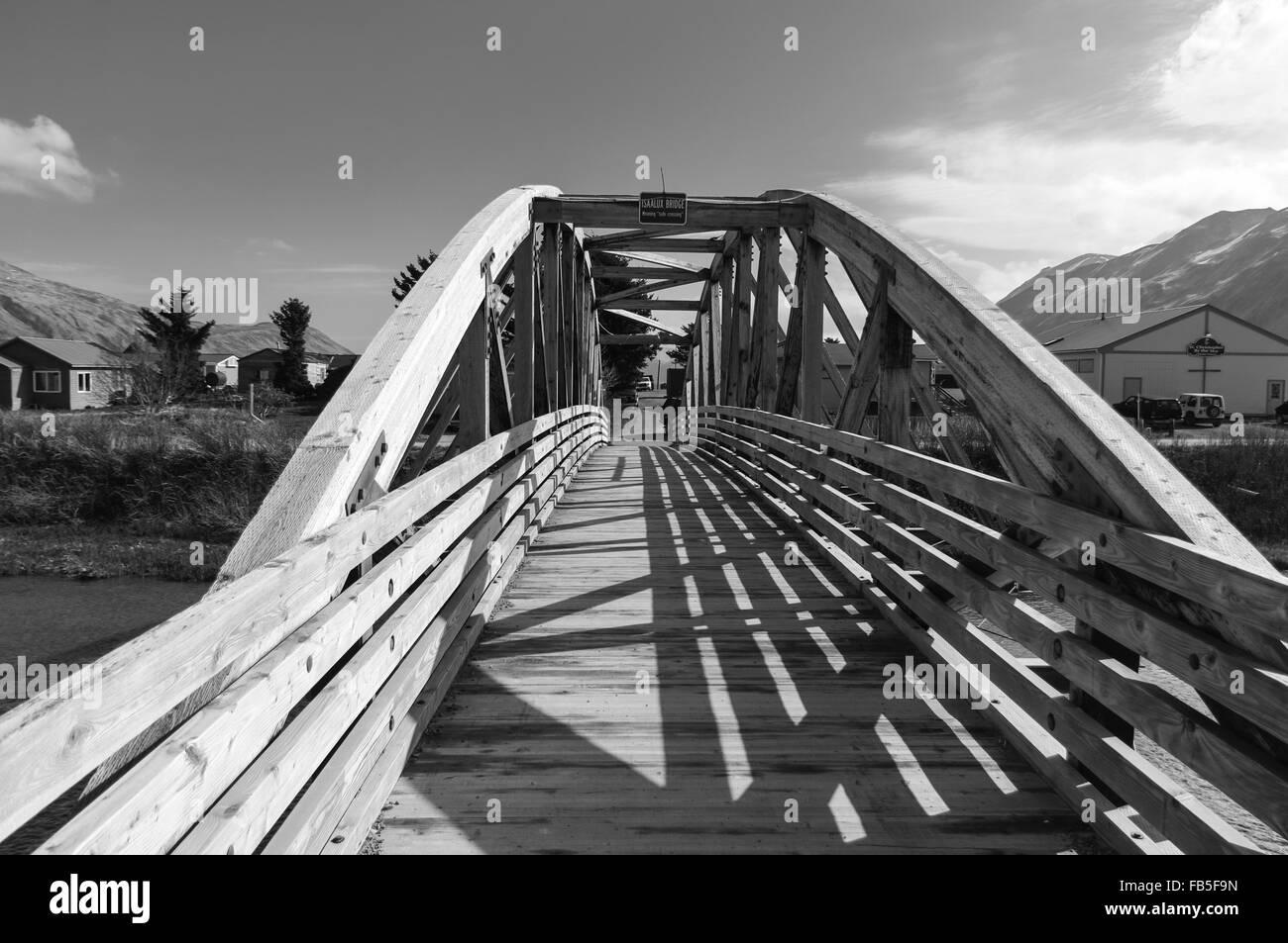 Black and white shot of the Isaalux cantilever foot bridge in Dutch Harbor/Unalaska, Alaska, USA. - Stock Image