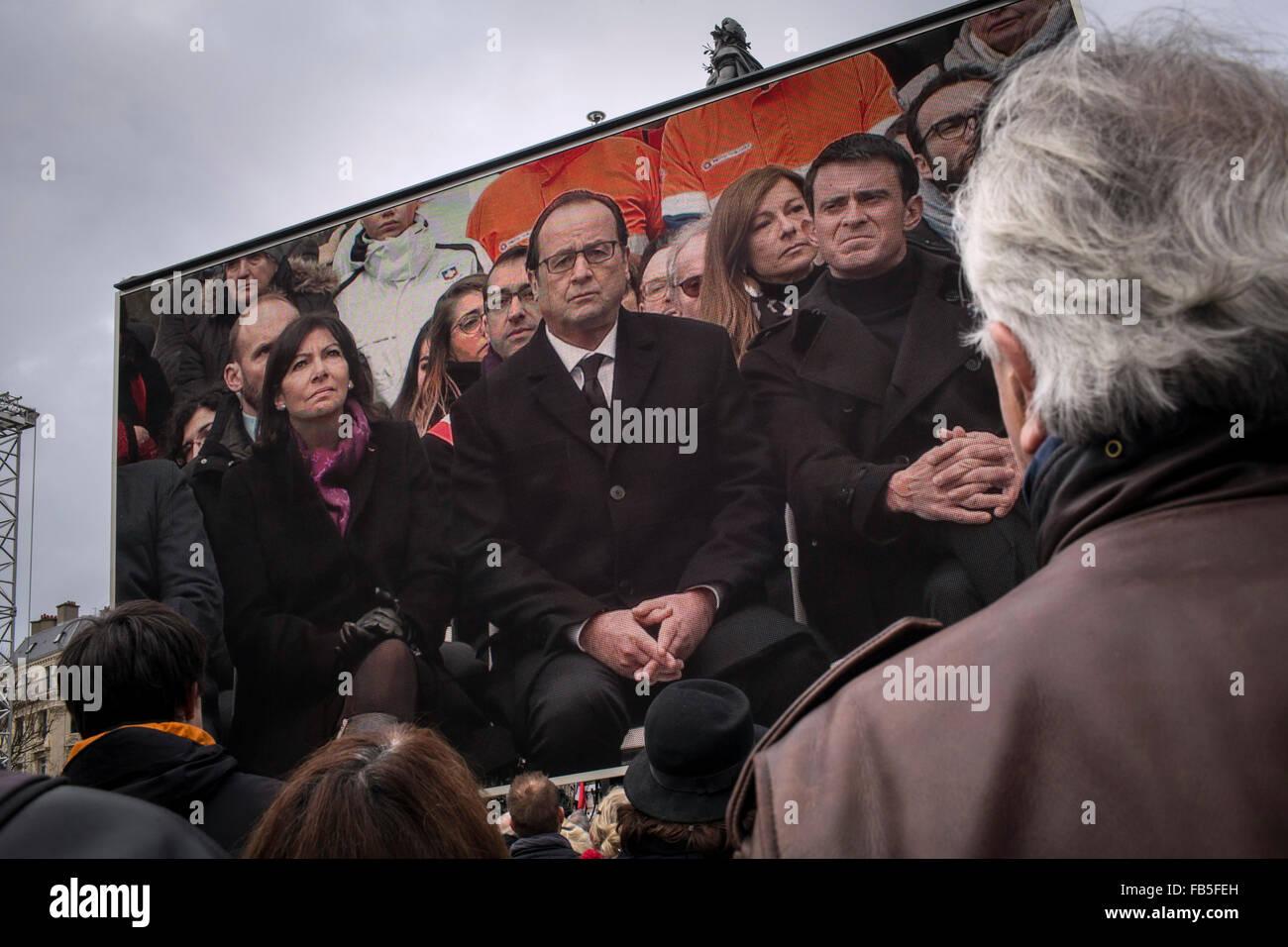 Paris, France. 10th Jan, 2016. A screen shows (L-R) Paris Mayor Anne Hidalgo, French President Francois Hollande, Stock Photo