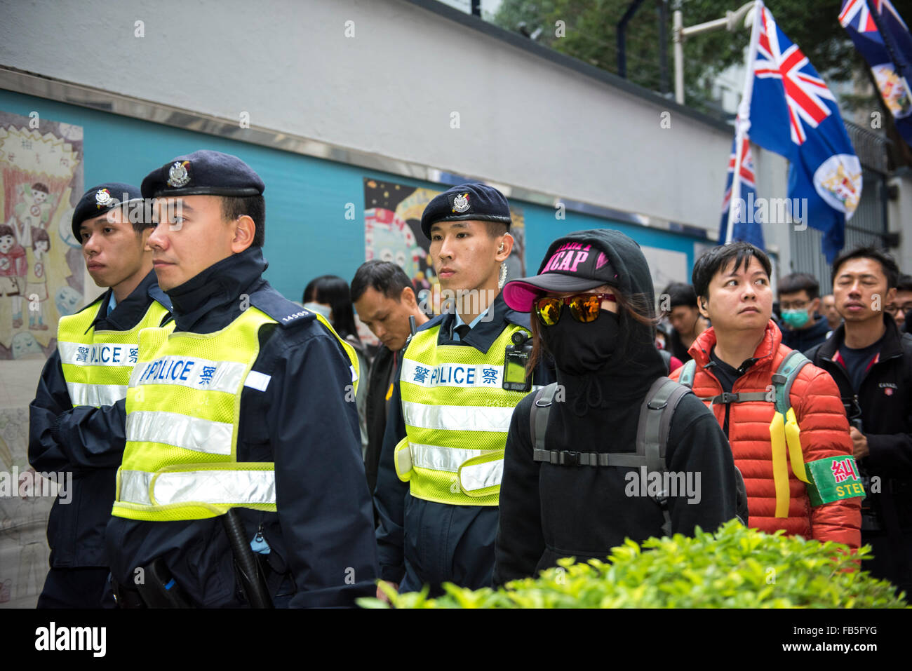 Hong Kong, China. 10th Jan, 2016. Surrounded by the police the so called protest 'trouble-makers are calling for Stock Photo