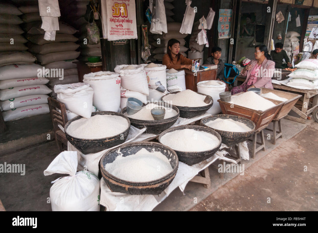 Large quantities of white rice on sale on a street market in Nyaung U, Bagan, Mandalay Region, Myanmar. - Stock Image