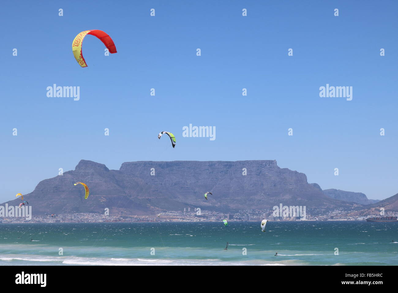 Kitesurfers at Bloubergstrand, Cape Town with Table Mountain in the background - Stock Image