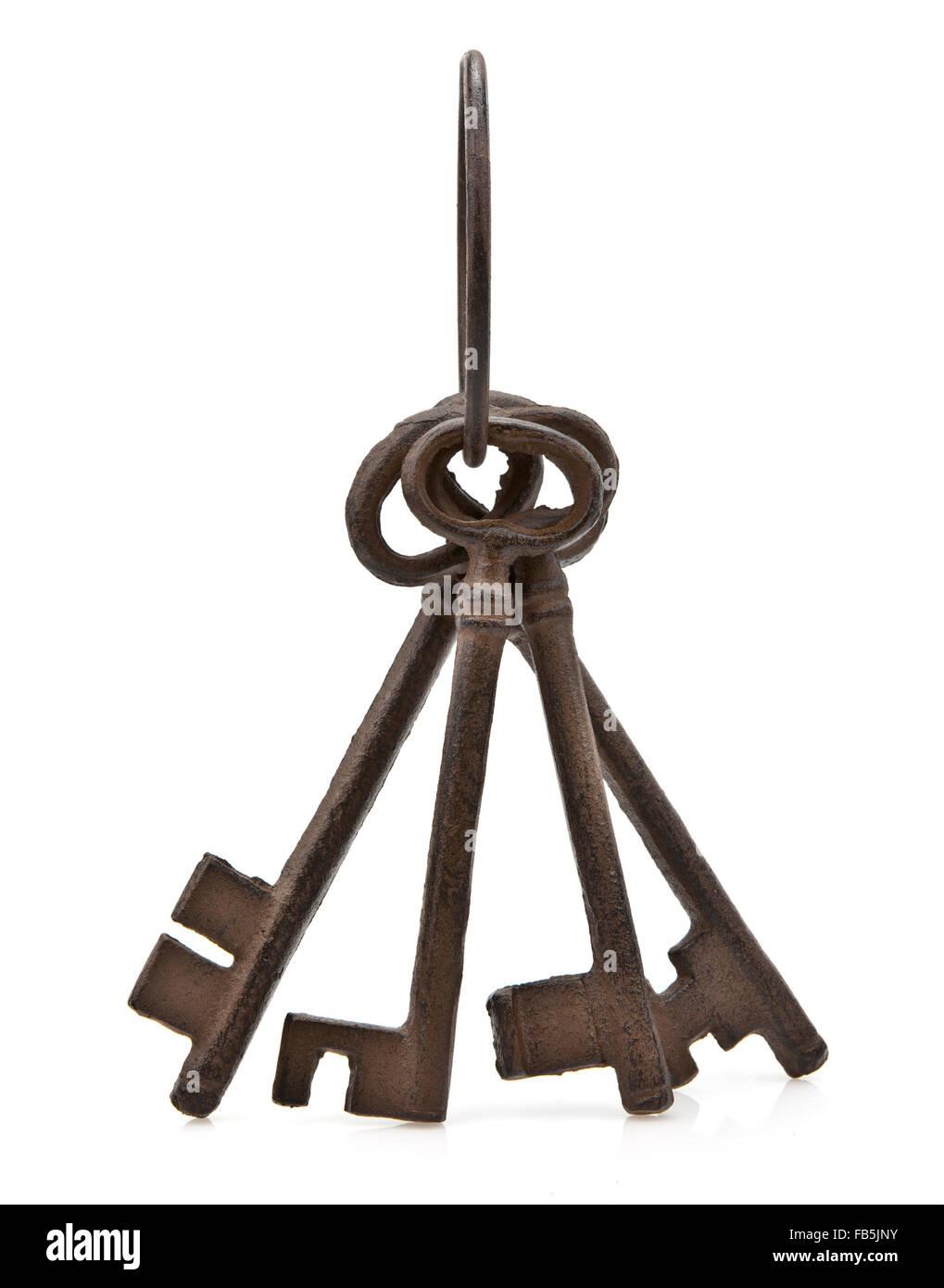 Set of old antique keys over white background - Stock Image