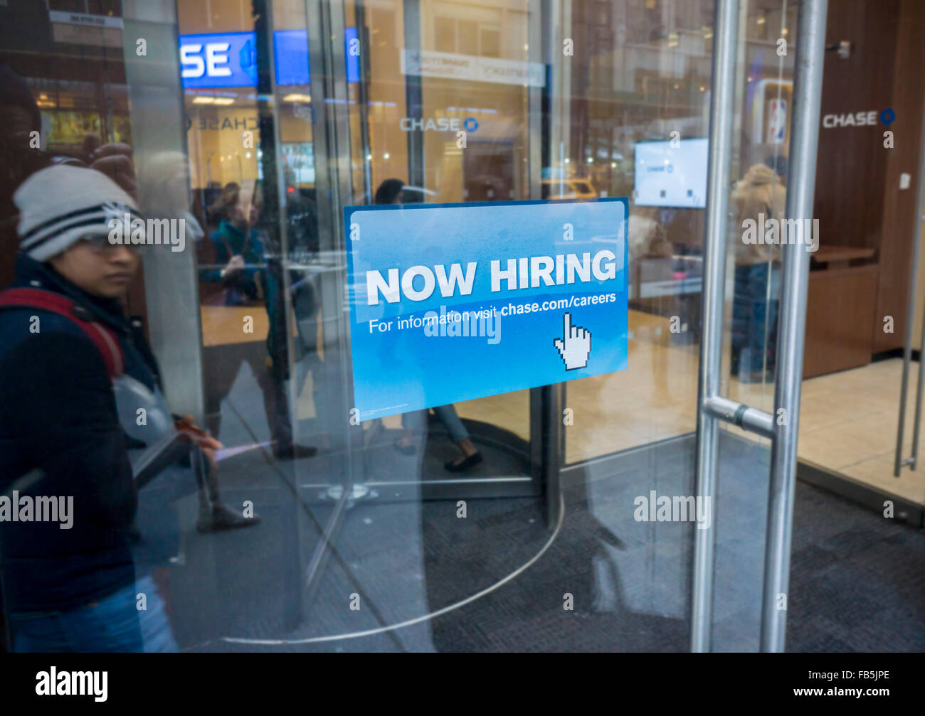 A sign in the window of a JPMorgan bank branch in New York advises