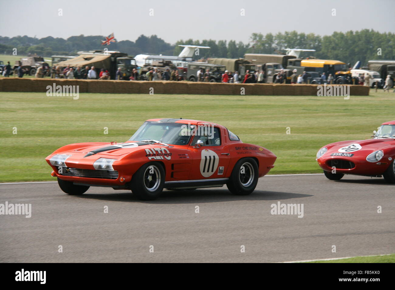 TWO RED CLASSIC RACING CARS AT GOODWOOD REVIVAL IN UK Stock Photo