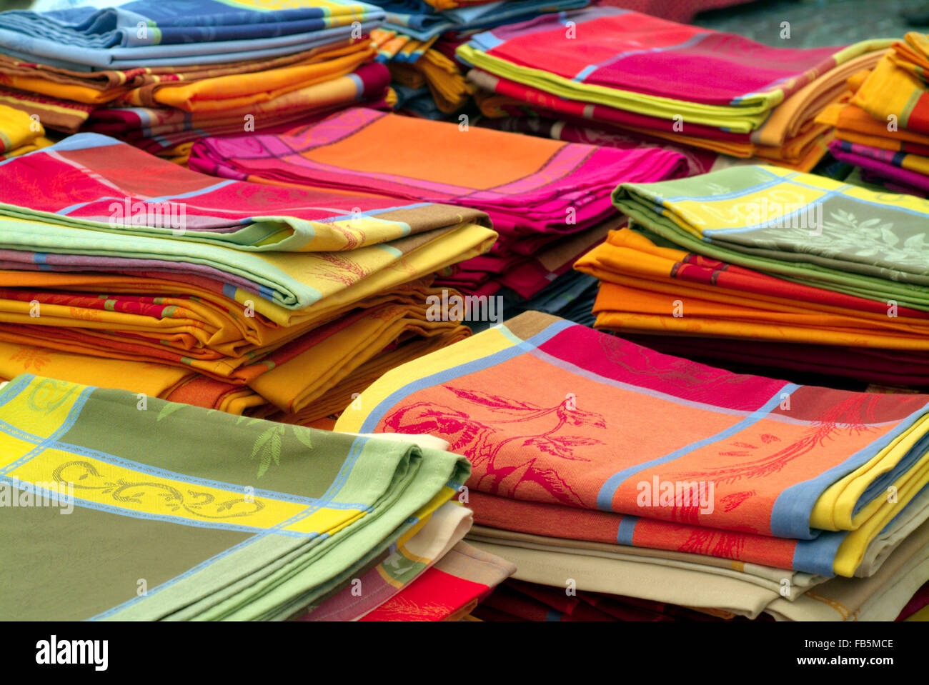 French tablecloths on a market, stacked provence france europe - Stock Image