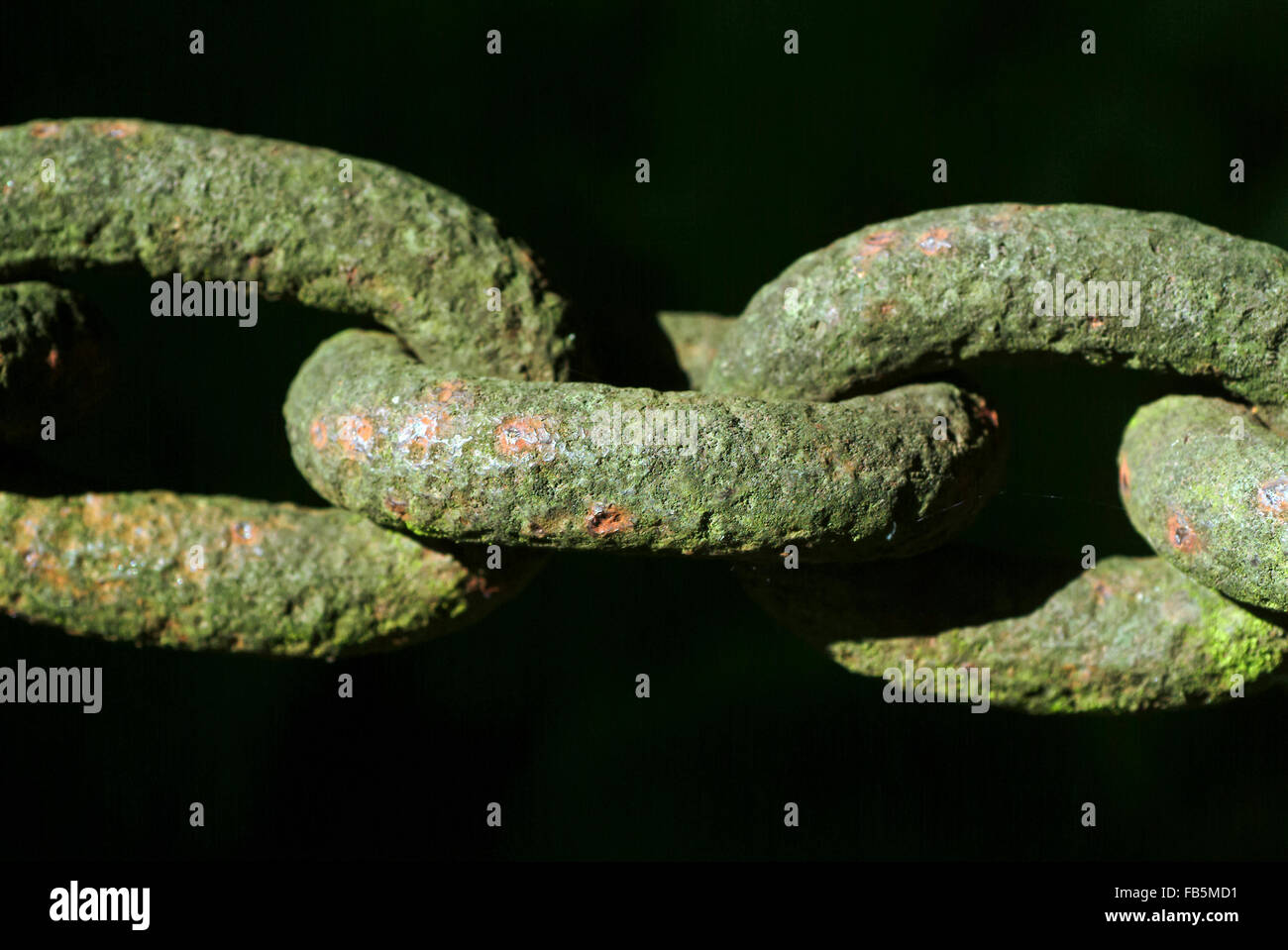 Rusty chain with black background - Stock Image