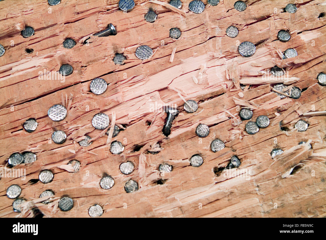Funfair, wooden board with driven nails into Germany Europe - Stock Image