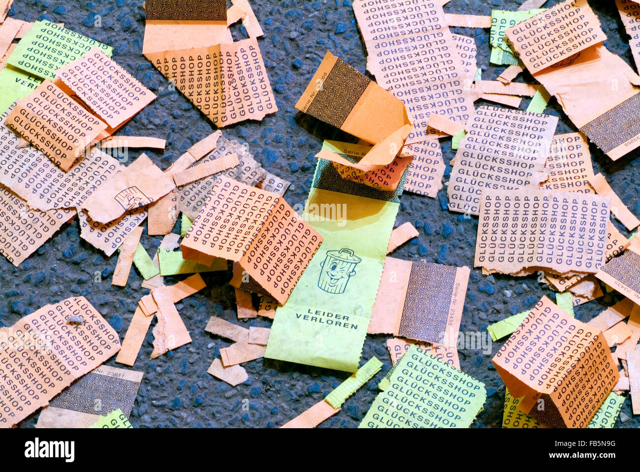 Thrown away blank tickets on a funfair laying on the ground germany europe - Stock Image