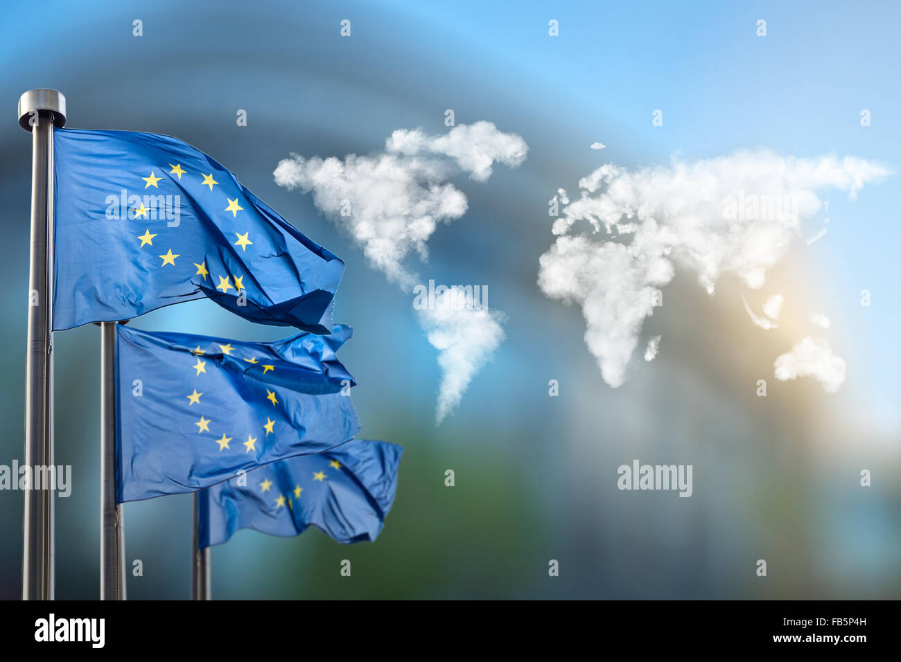 Flags of european union with world map made of clouds against stock flags of european union with world map made of clouds against european parliament in brussels belgium gumiabroncs Gallery