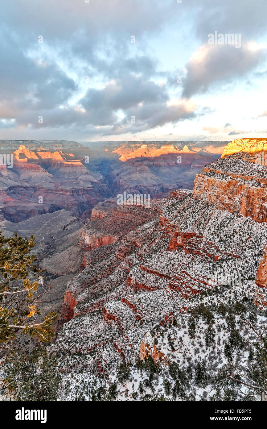 Snow-covered bluffs and canyons, from Rim Trail at the Village, Grand Canyon National Park, Arizona USA - Stock Image