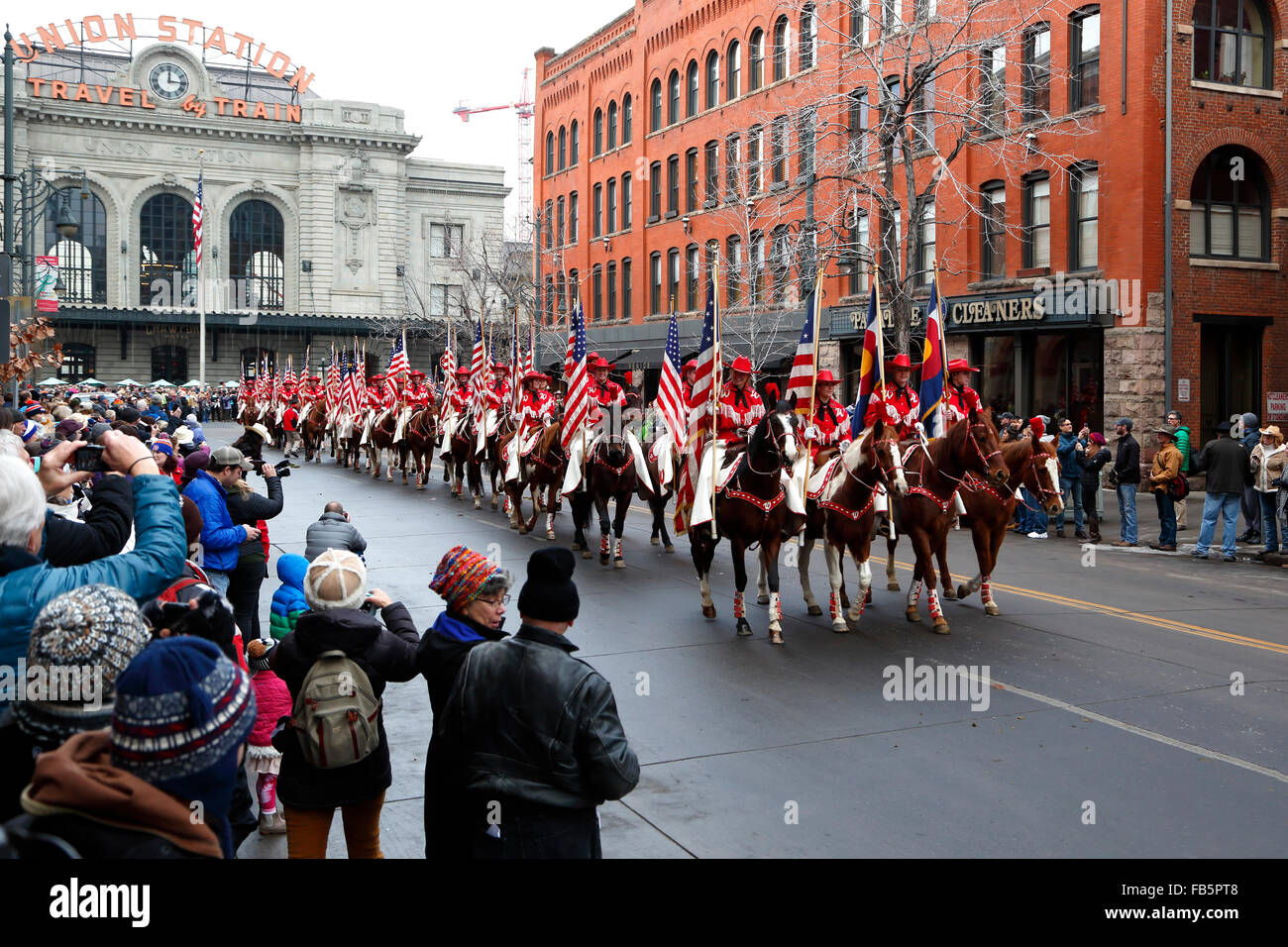 Red Division Westernaires carrying American flags, National Western Stock Show Kick-Off Parade, Denver, Colorado - Stock Image