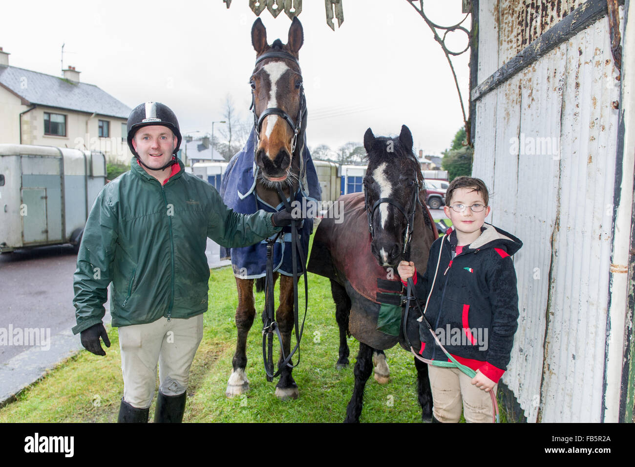 Drimoleague, Ireland. 10th January, 2016. Tim O'Leary and son, Michael from Skibbereen give their noble steeds - Stock Image