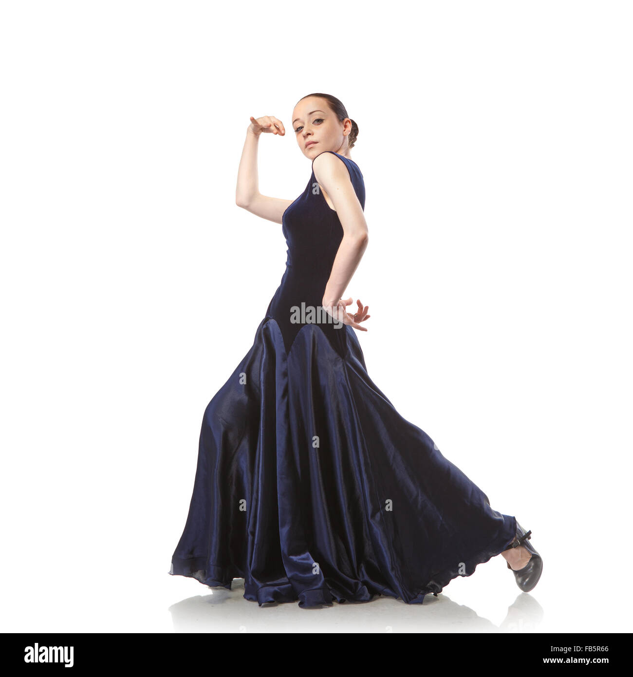 young woman dancing flamenco in blue dress isolated on white background - Stock Image
