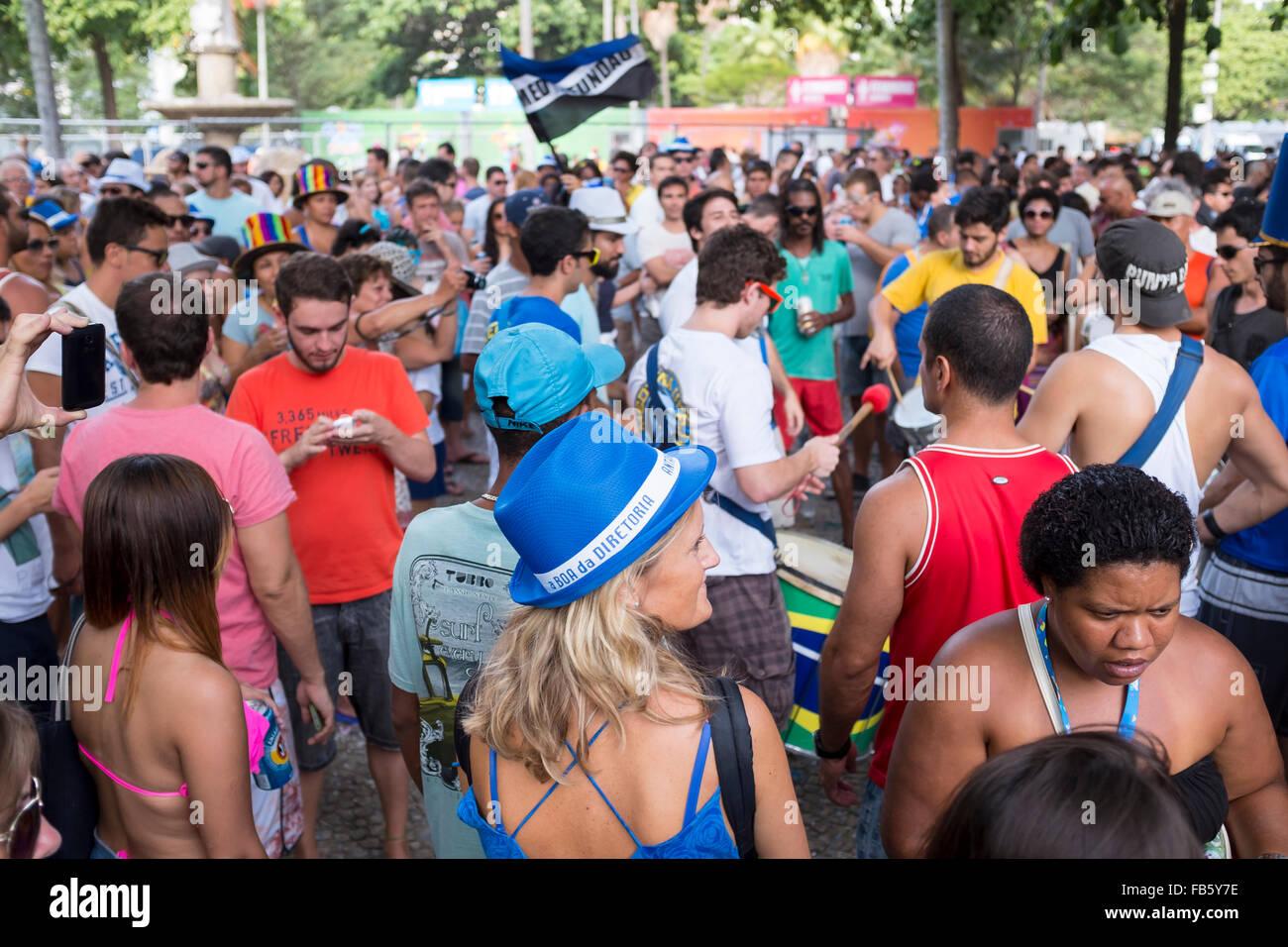 RIO DE JANEIRO, BRAZIL - FEBRUARY 28, 2014: Young Brazilians celebrate together at the Banda de Ipanema carnival Stock Photo