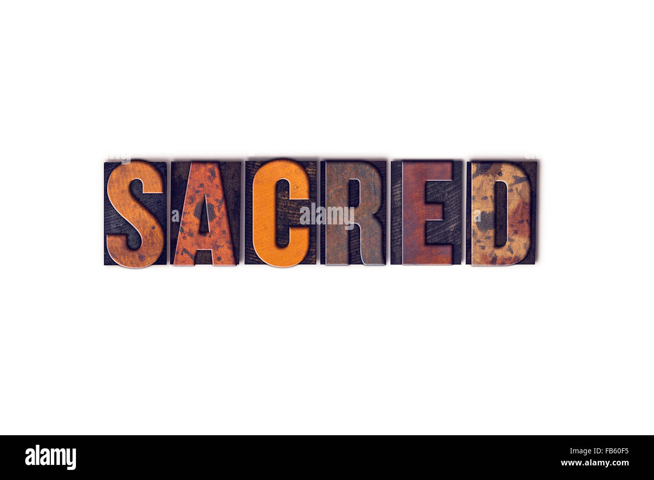 The word 'Sacred' written in isolated vintage wooden letterpress type on a white background. - Stock Image