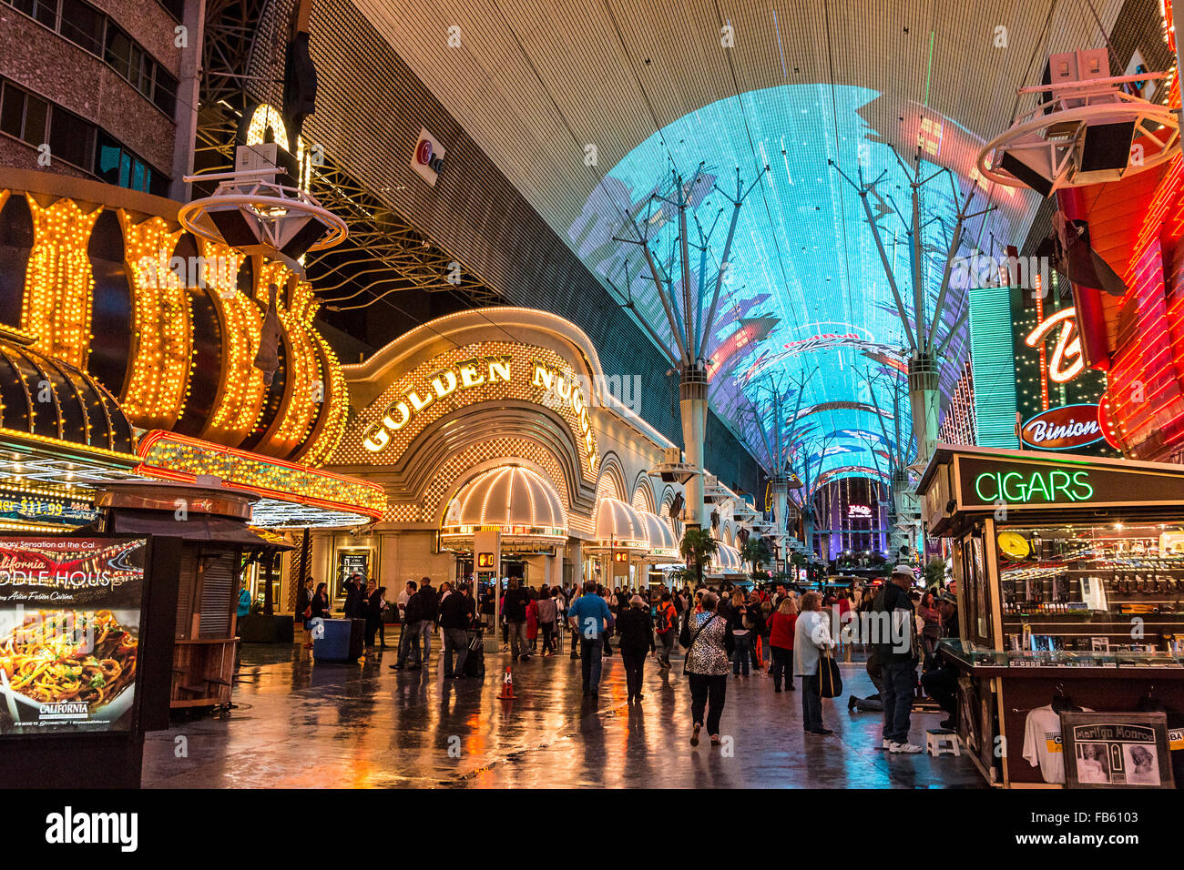 A rare rainstorm reflects neon lights along Fremont Street in downtown Las Vegas. - Stock Image