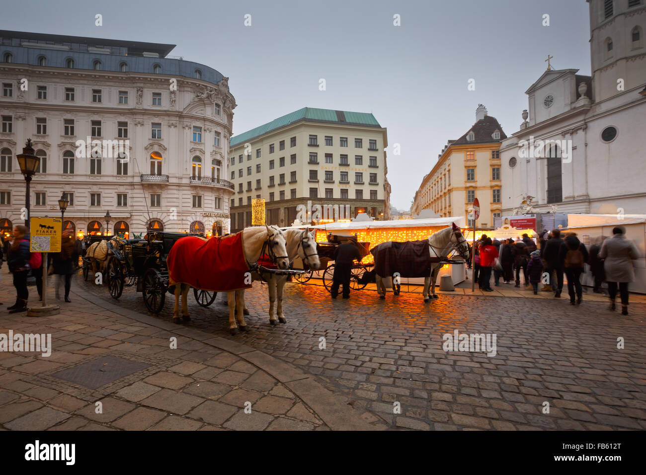 Carriages in front of the Hofburg palace in Vienna. - Stock Image