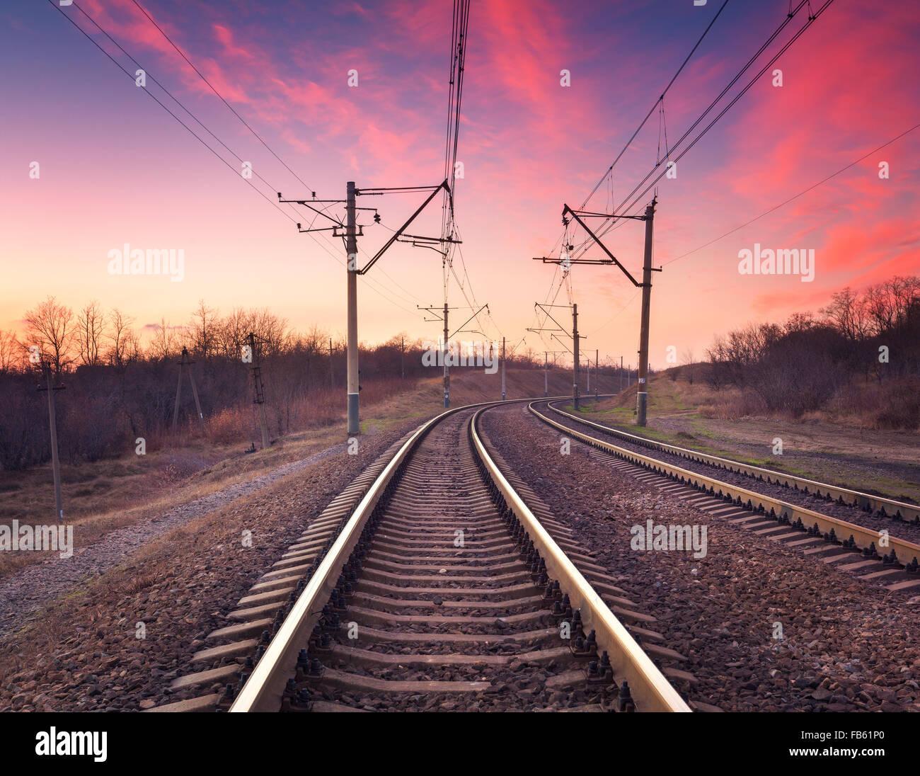 Train platform at sunset. Railroad in Ukraine. Railway landscape. - Stock Image