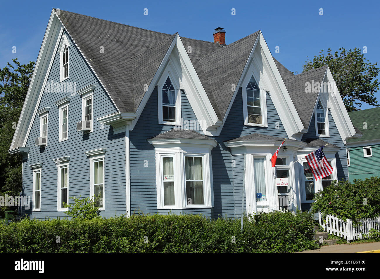 Amazing An American Flag Hangs Outside Of A Wooden House In Mahone Bay In Nova  Scotia, Canada. The Building Has A Painted Wooden Facade.