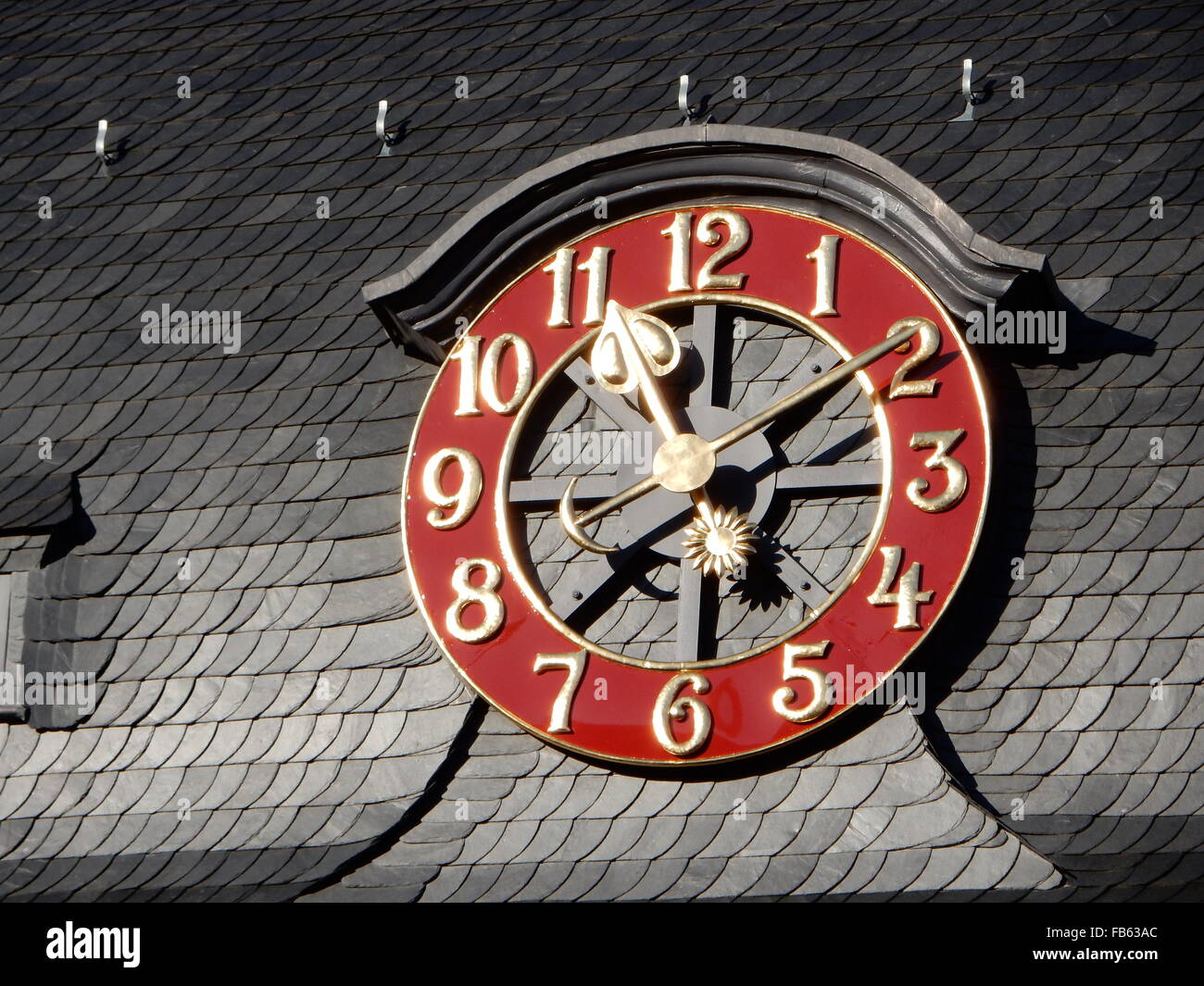 Watch with red dial-plate in Bonn, Germany - Stock Image