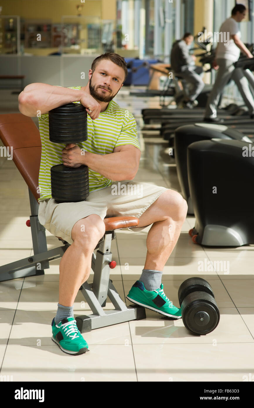 Sportsman in gym. - Stock Image