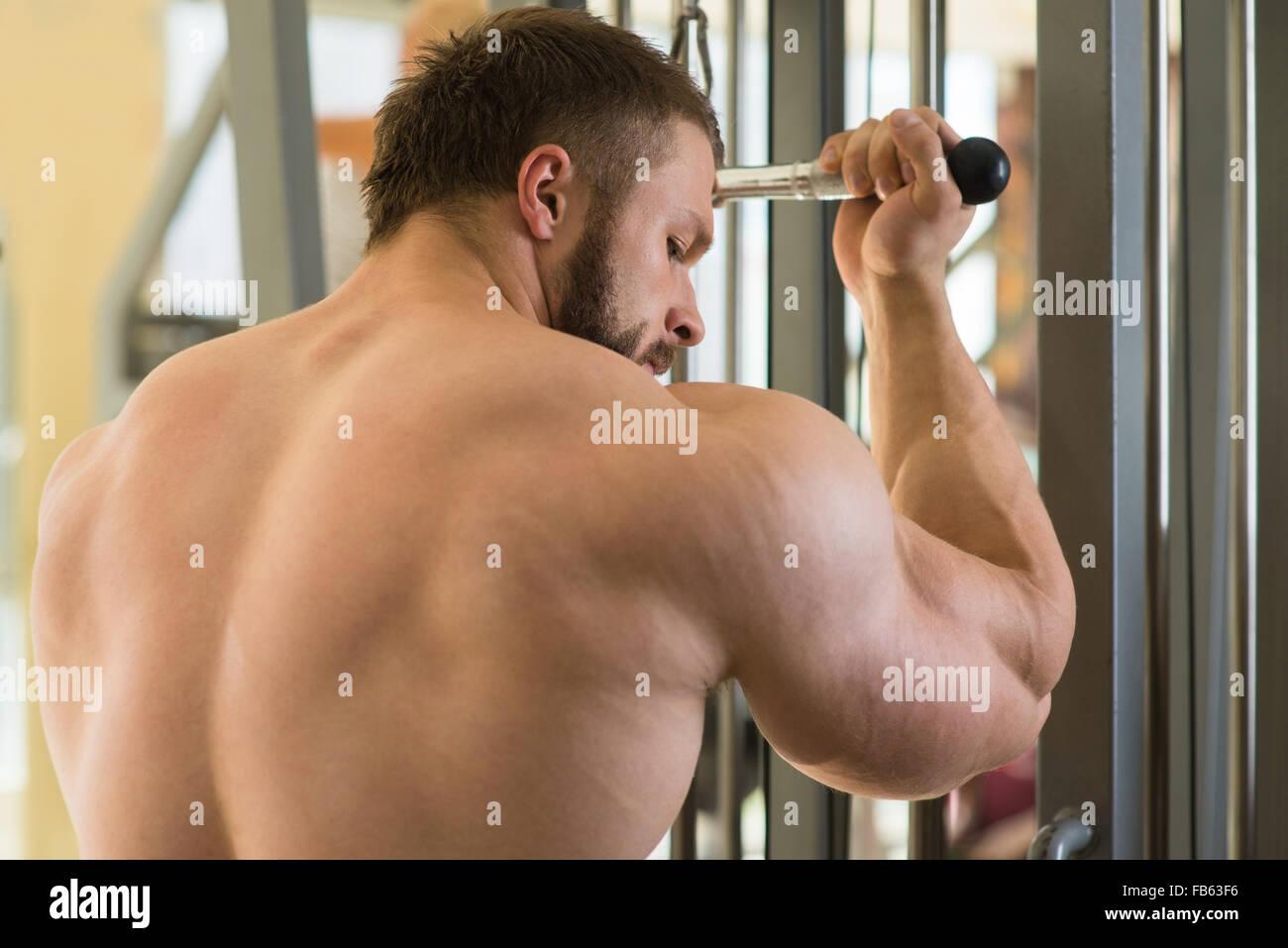 Brutal sportsman in gym. - Stock Image