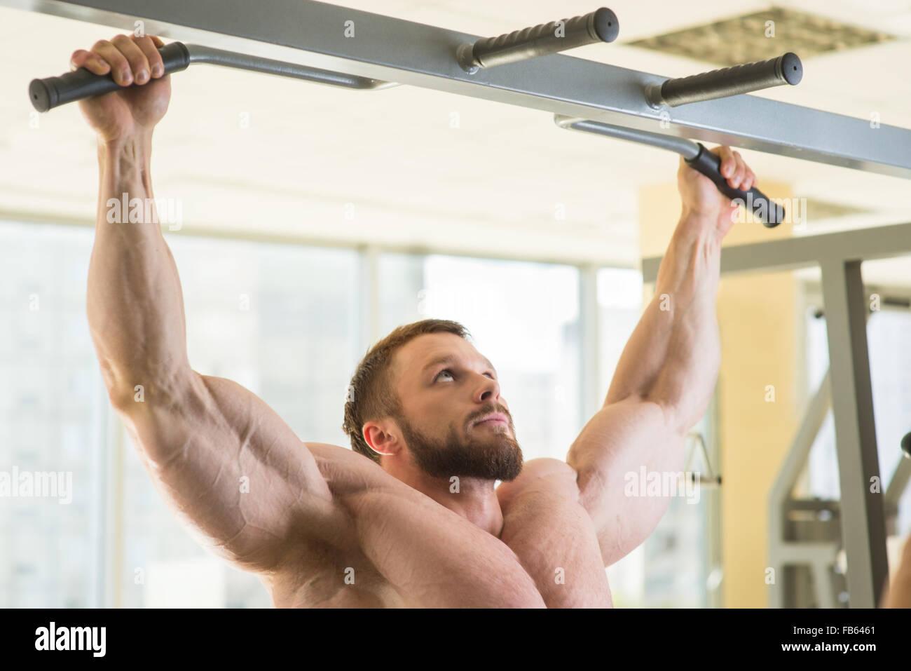 Bodybuilder doing pull-ups. - Stock Image