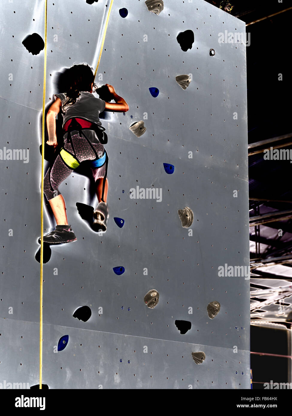 free climbing kids. Demonstration of training of indoor free climbing - Stock Image