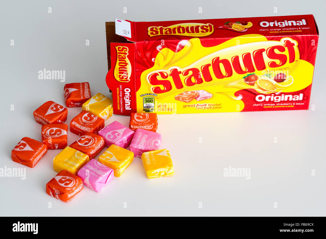 A box of Starburst candy, a fruit-flavored candy manufactured by the Wrigley Company. - Stock Image