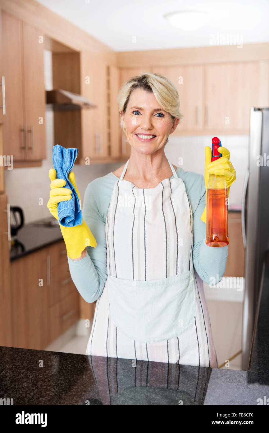 portrait of beautiful senior woman doing housework - Stock Image