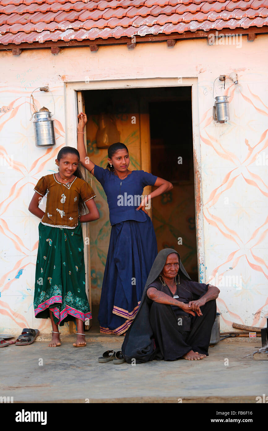 kacchi rabari desi laharia village woman with grand daughters in front of home kutch district gujarat india - Desi Home Pic