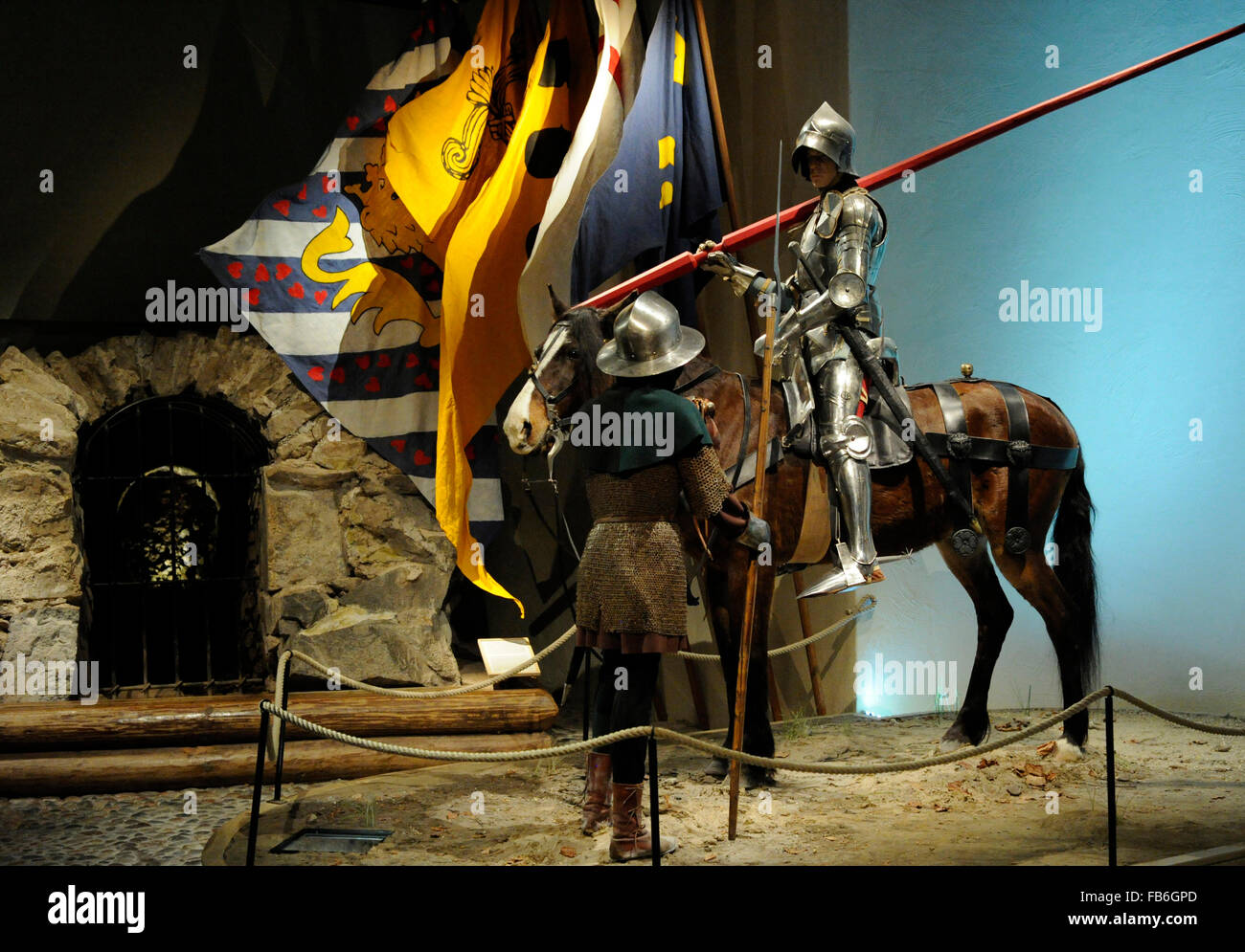 Figures showing a soldier on horseback and one on foot heading for the Battle of Brunkeberg (1471). Swedish army. - Stock Image