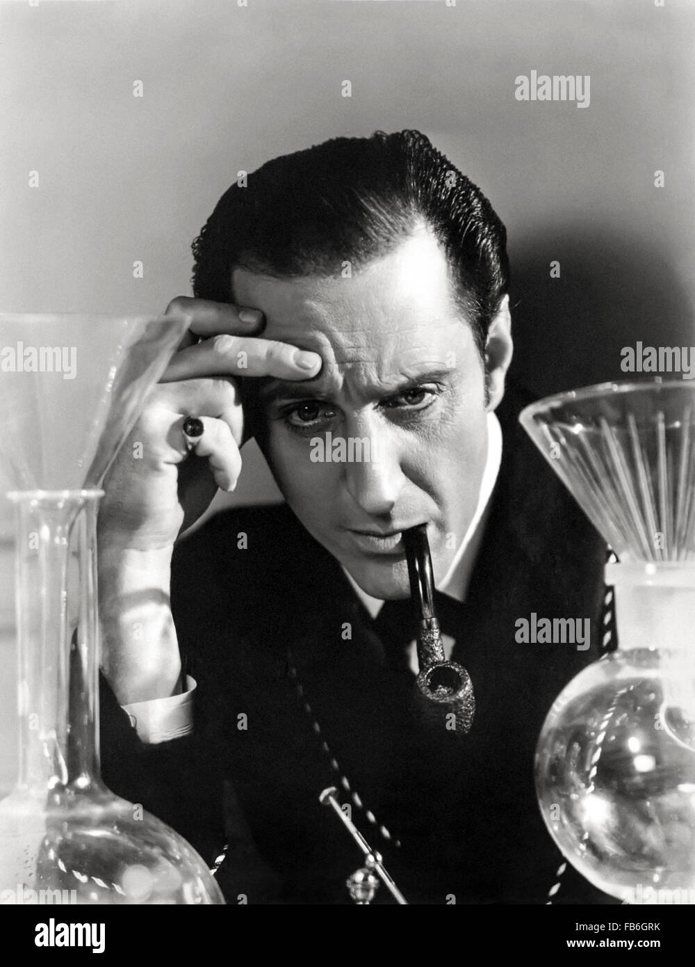 Publicity photograph showing Sherlock Holmes played by Basil Rathbone conducting a scientific experiment, released - Stock Image