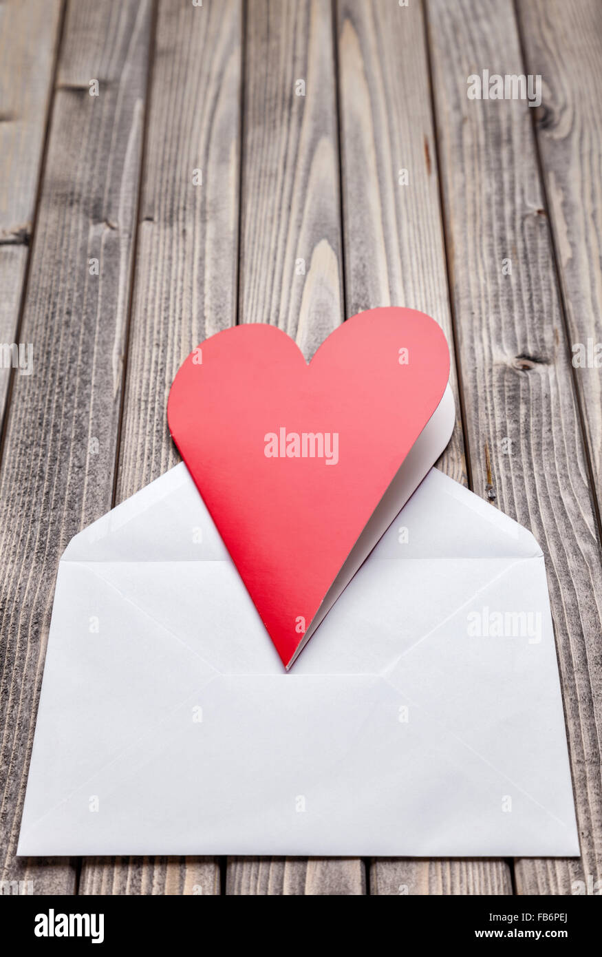 Romantic love letter on a wooden background - Stock Image