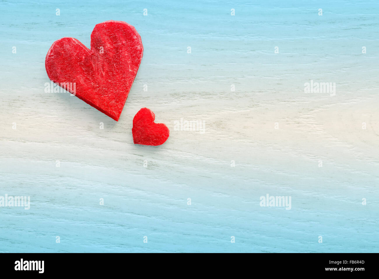 Retro stylized hearts made of beet on wooden background, space for text. - Stock Image