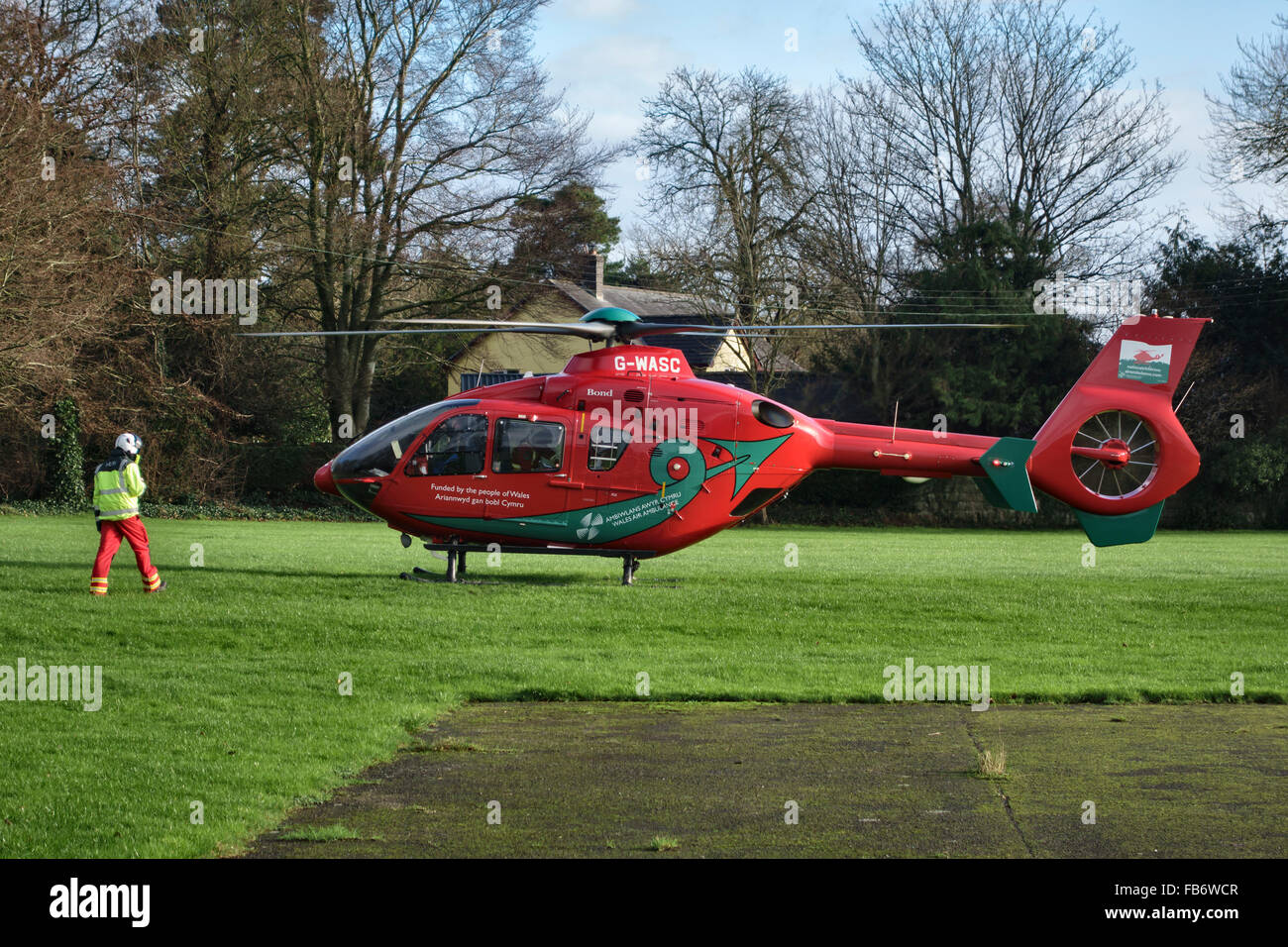 Presteigne, Powys, UK. The Wales Air Ambulance attends an incident in the town. A Eurocopter EC135 on the school - Stock Image