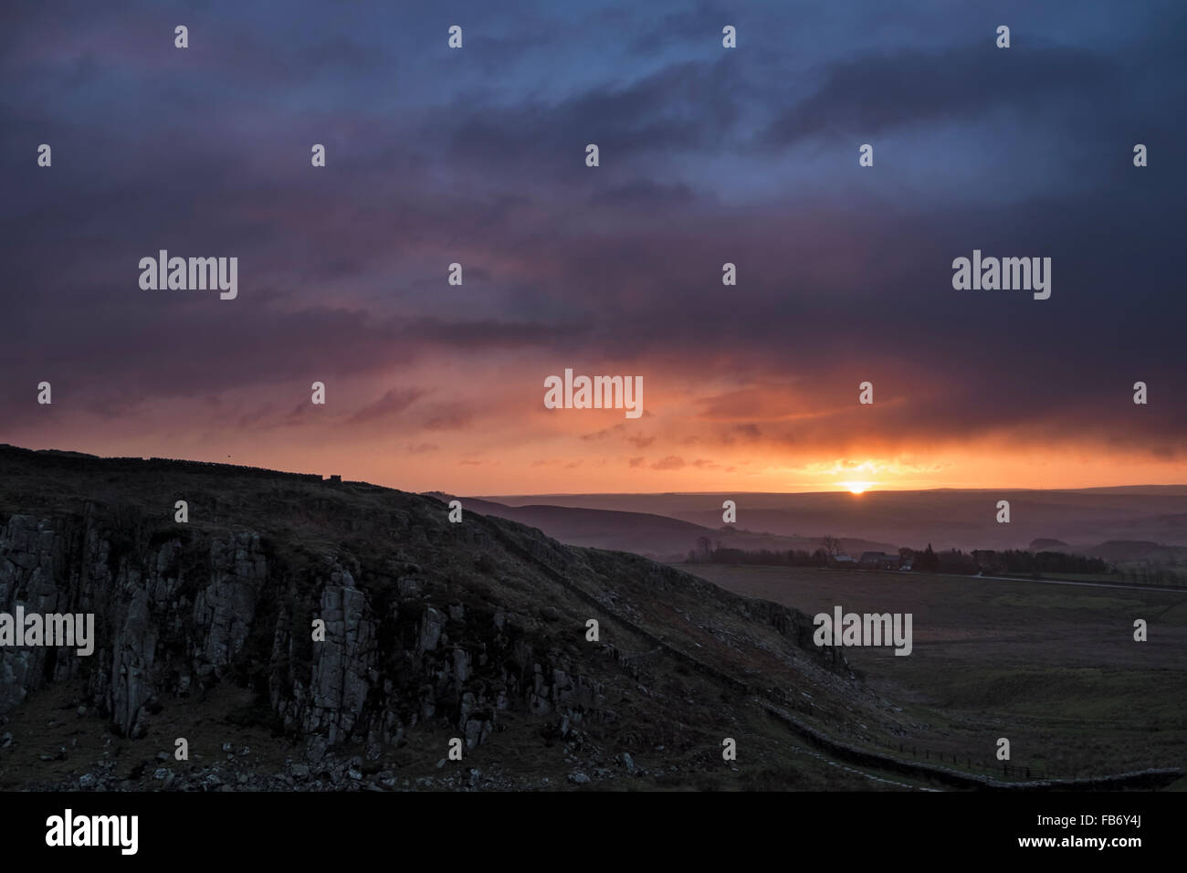 Winter sunrise over Peel Crag in Hadrian's Wall Country, Northumberland, England Stock Photo