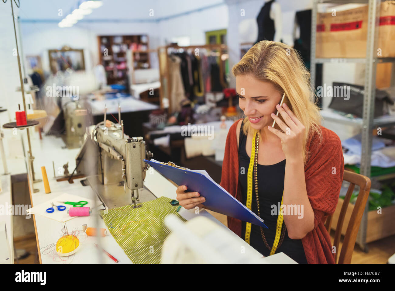 Young tailor woman - Stock Image
