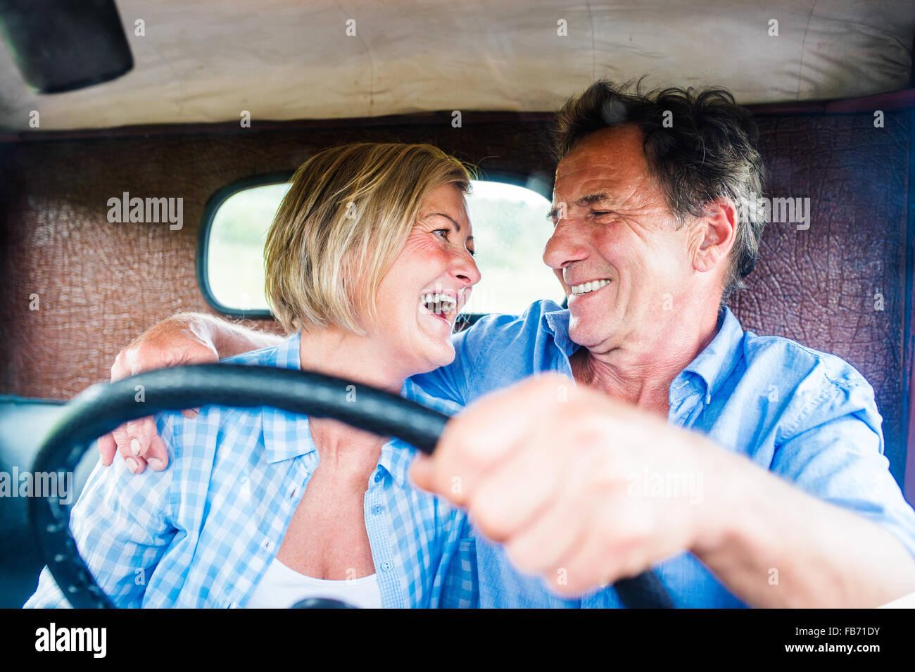 Senior couple in a car - Stock Image