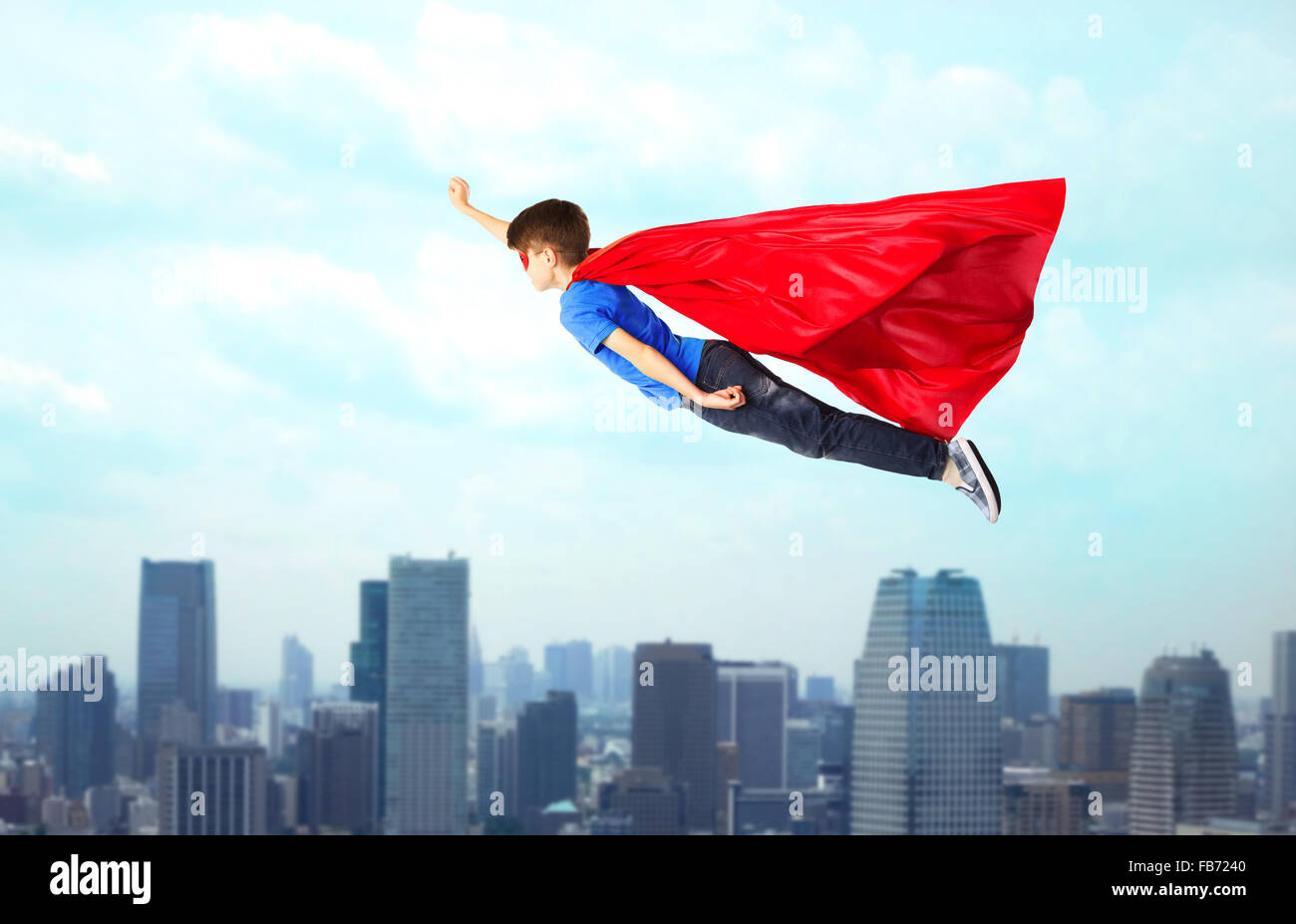 Superman flying stock photos superman flying stock images page 2 boy in red superhero cape and mask flying on air stock image publicscrutiny Gallery