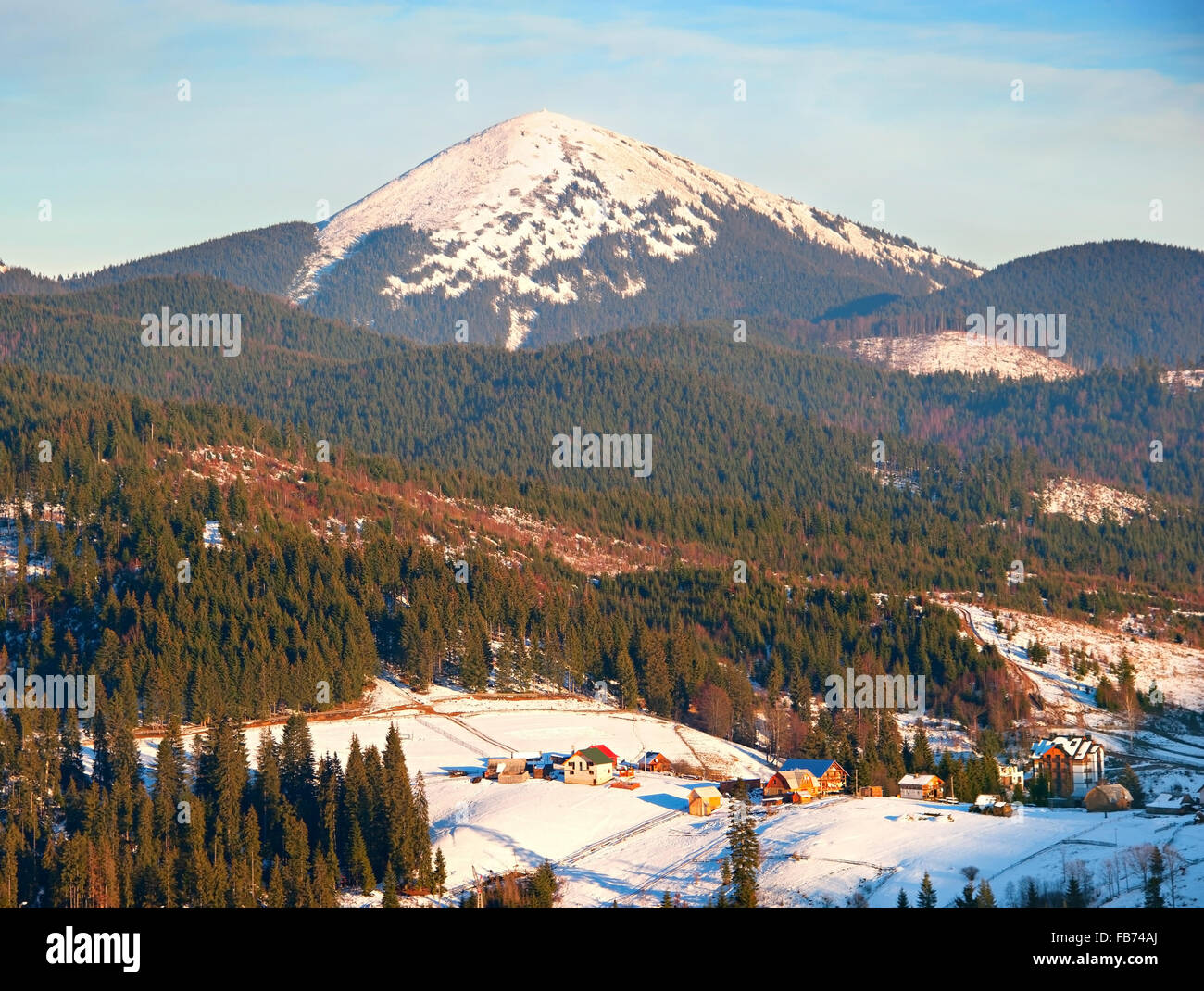 Carpathians mountain village in the winter at sunset. Ukraine Stock Photo