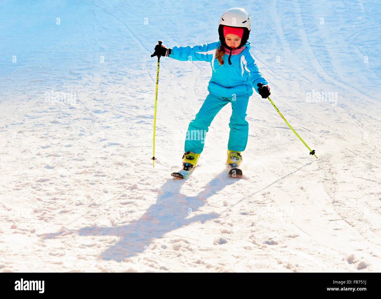Unidentified beautiful girl skiing at ski resort in Bukovel. Bukovel is the most popular ski re - Stock Image